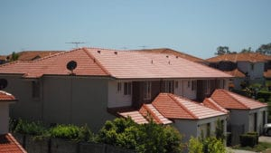 Brisbane Southside roof painting apply primer seal and roof membrane