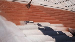 Sunshine Coast roof restoration apply treatments and paint coat by coat