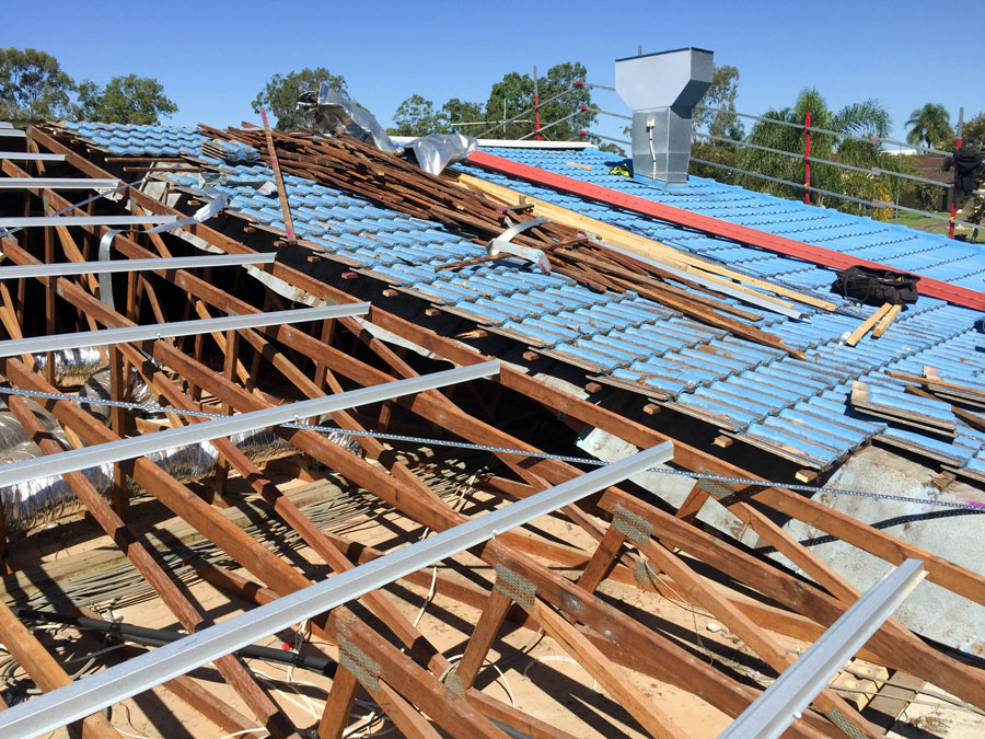 Brisbane tile roofing setup safety rails and remove tiles